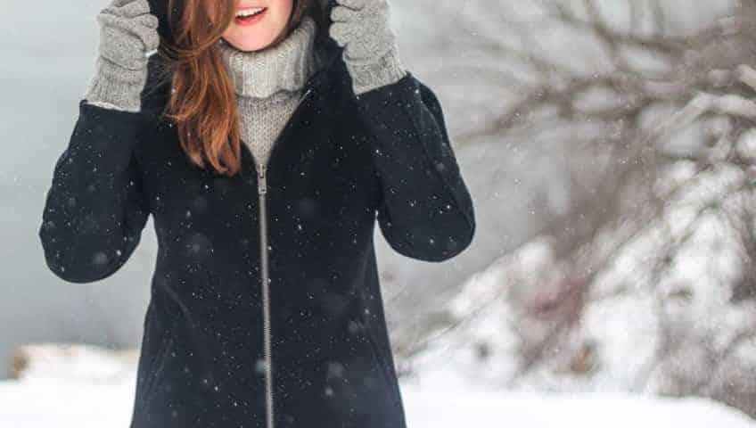 woman in the snow wearing designer clothes