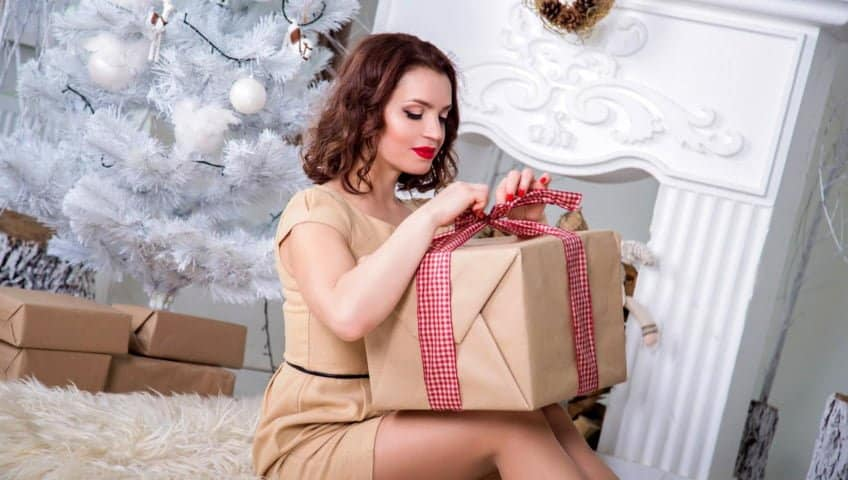 woman unwrapping gift box